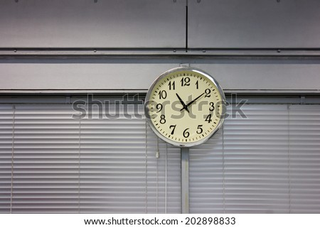 Clock hanging on the wall in office