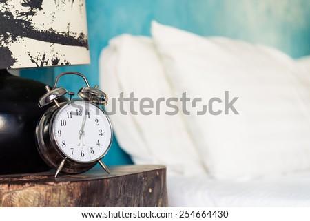 Clock in bedroom - stock photo