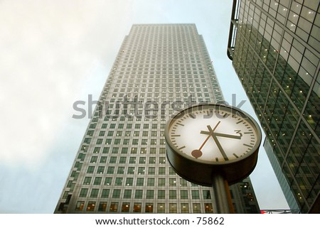 Clock in Front of a Corporate Building - stock photo