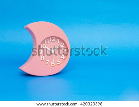 clock isolated on the blue - stock photo