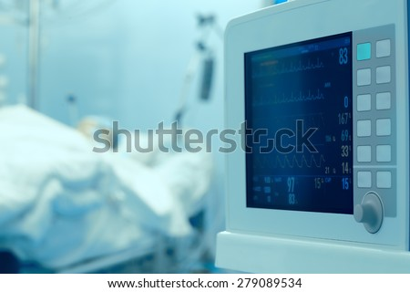 Clock monitoring of the patient's condition in the intensive care unit - stock photo