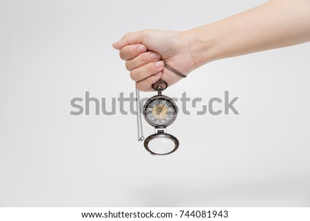 Clock on a hand on white background.