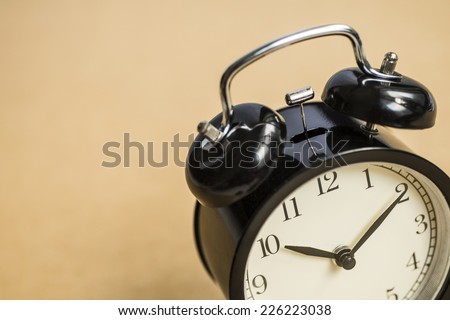 Clock on a wooden background