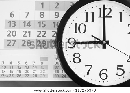 Clock on calendar background