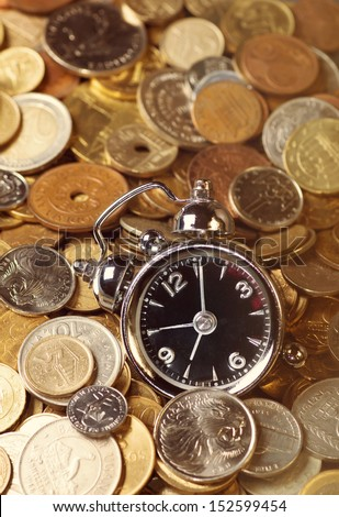 Clock on coins. Time is money concept.