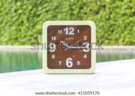 Clock on concrete floor at 10.15 A.M. - stock photo