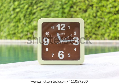 Clock on concrete floor at 11.15 A.M. - stock photo