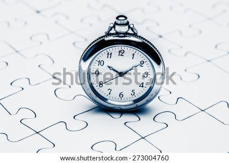 Clock on jigsaw Jigsaw and puzzles concepts - stock photo