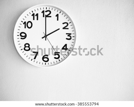 Clock on the wall for background - stock photo