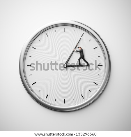 clock on the wall with businessman trying to stop time - stock photo