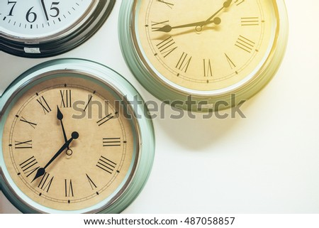 Clock on white wall background. Vintage effect. Concept of Time.