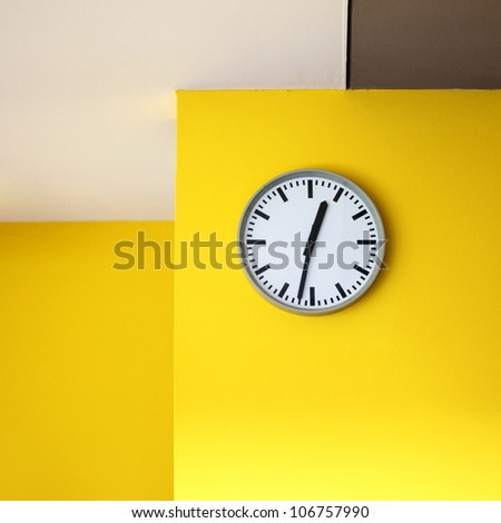 clock on yellow wall - stock photo
