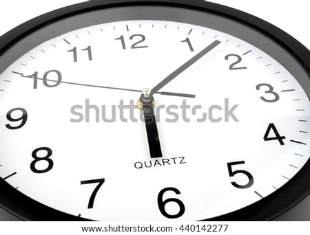 Clock or time abstract background, white clock and black needles, six o'clock, seven minutes
