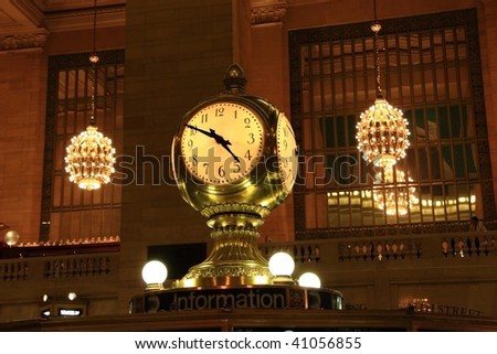 Clock over the information booth in the middle of the great hall in Grand Central Terminal - New York