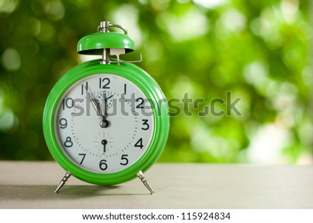 Clock showing five to twelve,Clock - stock photo