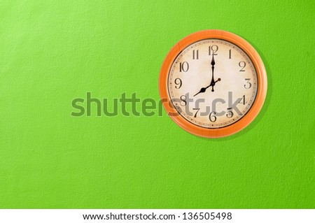 Clock showing on a green wall