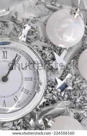 clock striking midnight silver holiday decor - stock photo