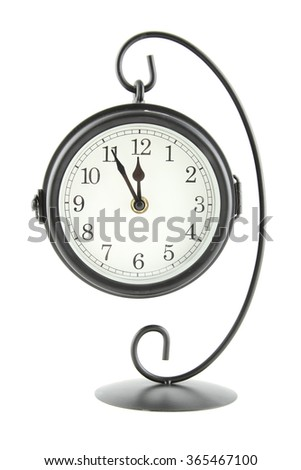clock suspended on an iron stand. Isolated - stock photo