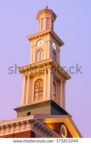 Clock tower in Baltimore downtown in the early winter morning. A clear morning sky over the Sports museum clock tower in Baltimore.  - stock photo