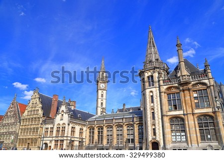 Clock tower of the old Post Office above beautiful Gothic buildings in Ghent, Belgium