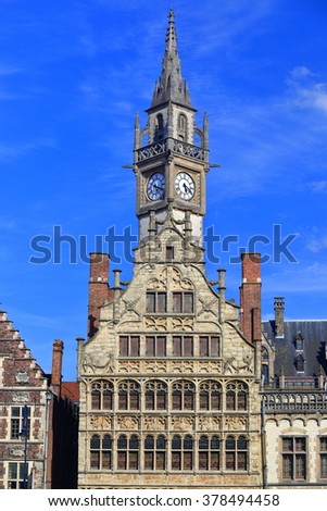 Clock tower of the Old Post Office above medieval buildings of Ghent, Belgium