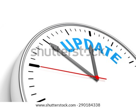 Clock Update - Clock containing the text update. - stock photo