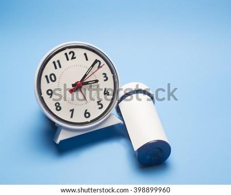 Clock with a prescription bottle/Insomnia/Prescription bottle and an alarm clock - stock photo