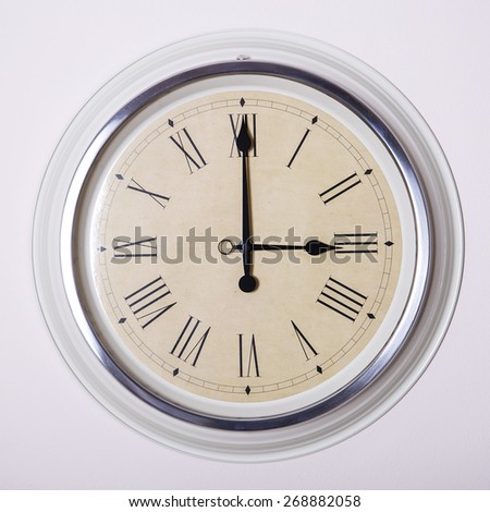 clock with Roman numerals at 3 o'clock - stock photo