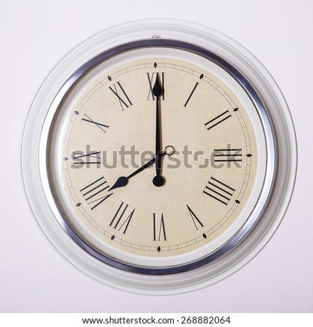 clock with Roman numerals at 8 o'clock - stock photo