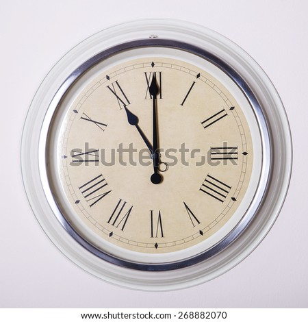clock with Roman numerals at 11 o'clock - stock photo