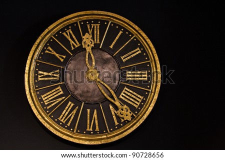 Clock with Roman numerals on a black background - stock photo
