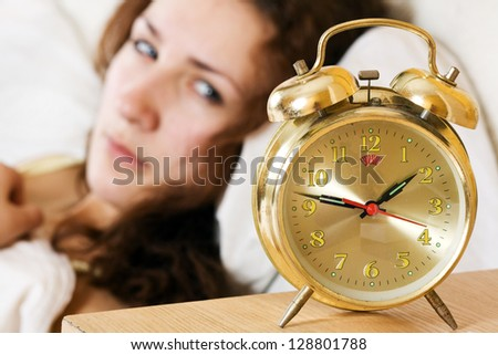 Clock with sleep at night. Woman can not sleep. - stock photo