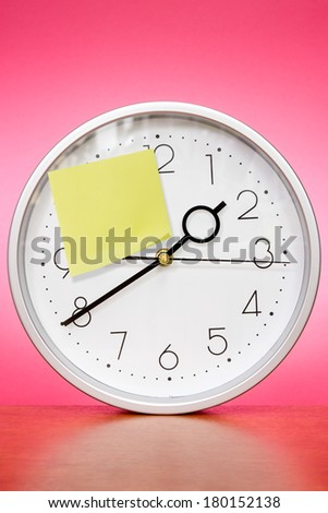 Clock with sticky paper for your own text - stock photo