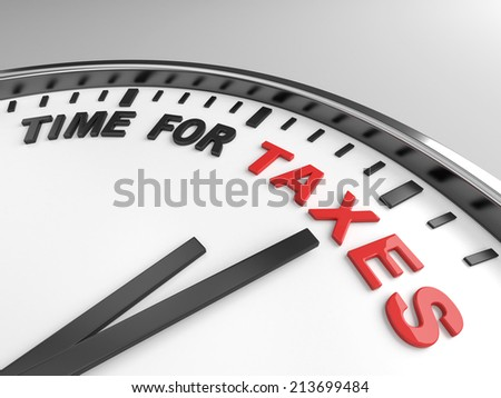 Clock with words time for taxes on its face - stock photo