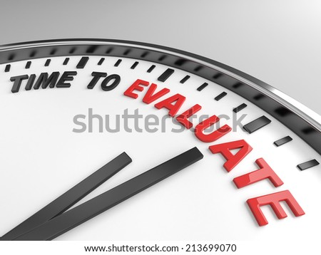 Clock with words time to evaluate on its face - stock photo