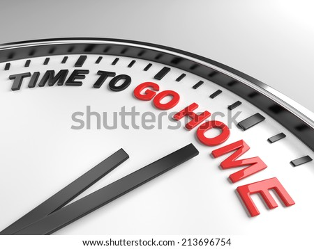 Clock with words time to go home on its face - stock photo