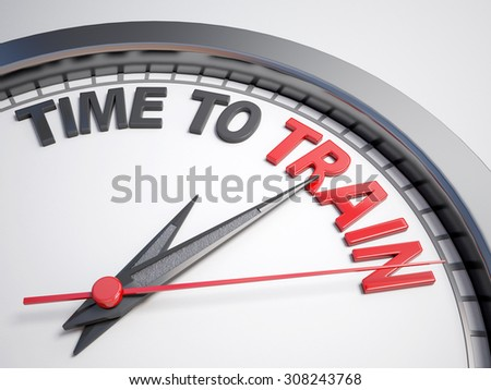 Clock with words time to train on its face