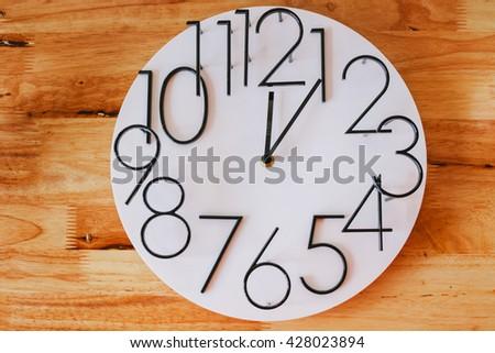 CLOCK  Wooden floor - stock photo