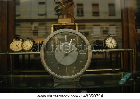clocks in the shop window, time passing concept  - stock photo