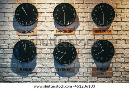 Clocks Shows Different Time Zones. Business Office Concept. Loft Interior  Wallpaper. Vintage Effect