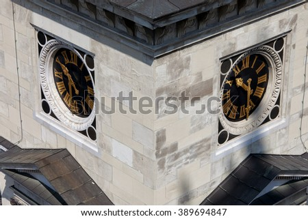 Clocks with Roman Latin numbers on St Stephen Basilica bell tower, clocktower in Budapest, Hungary, closeup, architectural detail