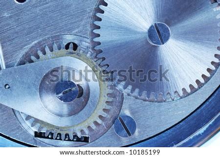 Clockwork close-up. Toned. - stock photo