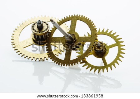 clockwork gears on white background - stock photo