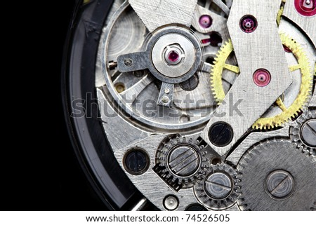 Clockwork macro isolated over the black background