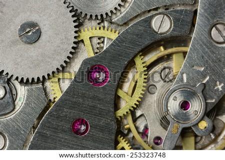 Clockwork of an old mechanical clock close up - stock photo