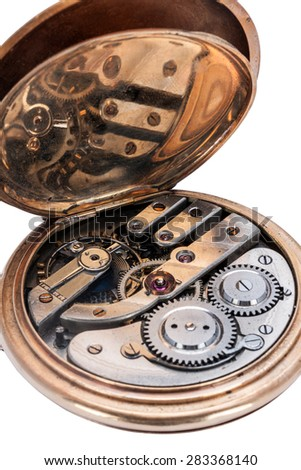 Clockwork of old pocket watches with selective focus on the pendulum isolated on white background - stock photo