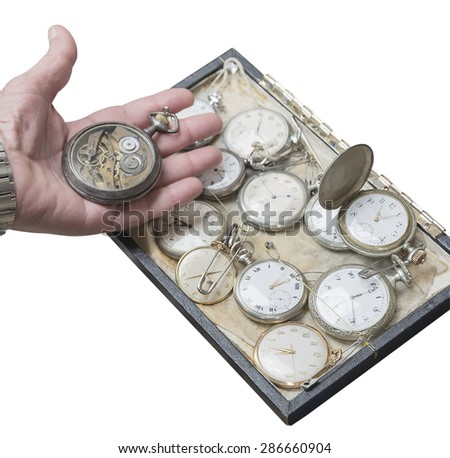 clockwork old pocket watch in a hand isolated on white background - stock photo