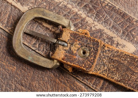 Cloesup of a leather handbag with a belt buckle