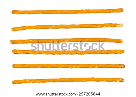 Cloesup of a salty sticks isolated on white background - stock photo