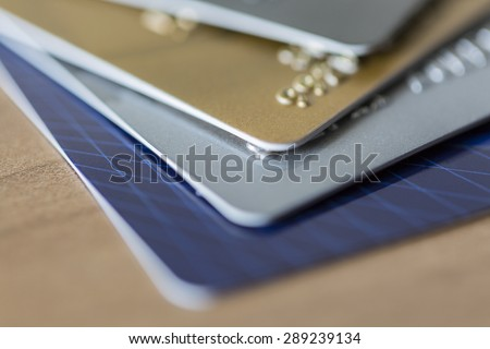 Cloesup view of credit cards in blue, silver, gold and platinum black - stock photo